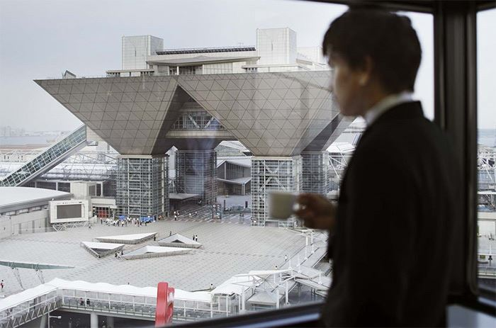 ariake business man looking at tokyo big sight