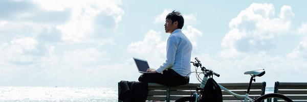 Servcorp Virtual Office man on laptop outside