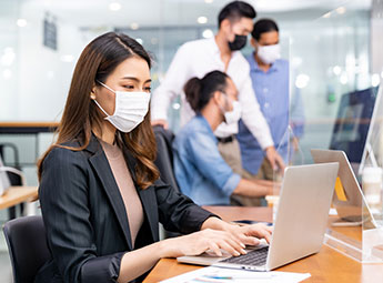 People working in a Serviced Office with masks on