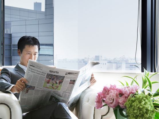 Ariake Frontier Building Waiting Area Man Reading Newspaper